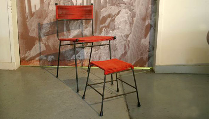 Meadmore chair and stool done in a red cord . Call for price .